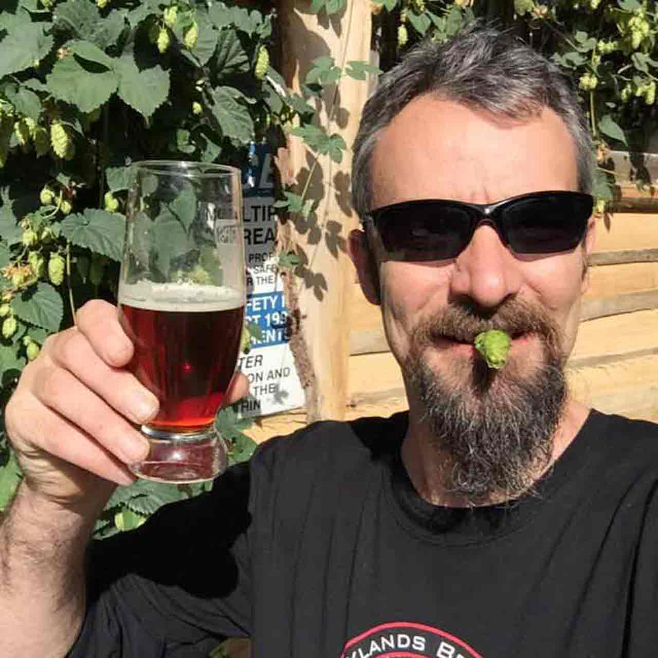 Paul Wicksteed with hop in mouth
